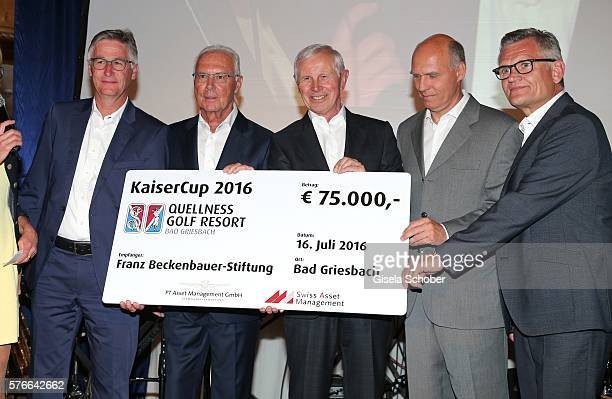 Gundis Zambo Martin Eininger Franz Beckenbauer Hans Dieter Cleven son Thomas Beckenbauer and Klaus Lehr with check during the Kaiser Cup 2016 gala on...