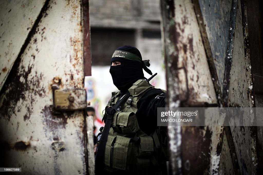 A gunman from the Ezzedine al-Qassam Brigades, the armed wing of Hamas, guards the door of the house of their late leader Ahmed Jaabari, as mourners visit to pay their condolences to his family in Gaza City on November 22, 2012. Israeli politicians returned to the campaign trail as the streets of Gaza came back to life after a truce ended eight days of bloodshed, with both sides claiming victory while remaining wary.