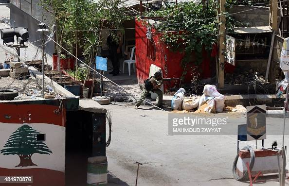 A gunman takes position in the Ain ElHelweh Palestinian refugee camp near Lebanon's southern port city of Sidon during fighting between members of...