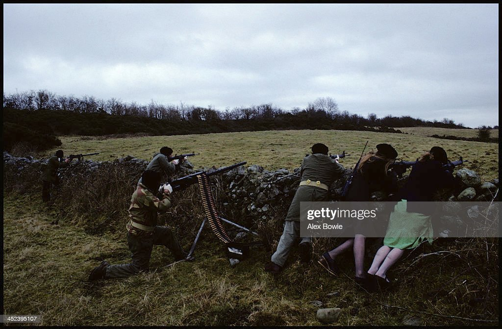 IRA gunmen and women with a Browning .50 calibre heavy machine gun and US-made AR15 rifles during a training and propaganda exercise in Northern Ireland, 12th February 1977.
