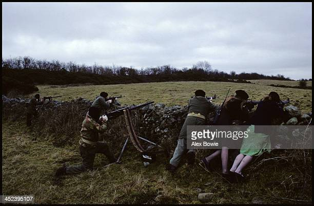 IRA gunmen and women with a Browning 50 calibre heavy machine gun and USmade AR15 rifles during a training and propaganda exercise in Northern...