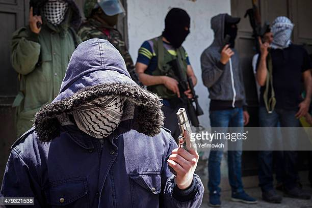 Gunmen appear during funeral of Mohammed Sami alKsbeh who was shot this morning during confrontation with Idf at qalandia checkpoint on July 3 2015...