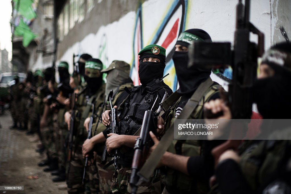 Gunmen from the Ezzedine al-Qassam Brigades, the armed wing of Hamas, line up outside the house of their late leader Ahmed Jaabari, after mourners finished visiting his family to pay their condolences in Gaza City on November 22, 2012. Israeli politicians returned to the campaign trail as the streets of Gaza came back to life after a truce ended eight days of bloodshed, with both sides claiming victory while remaining wary.
