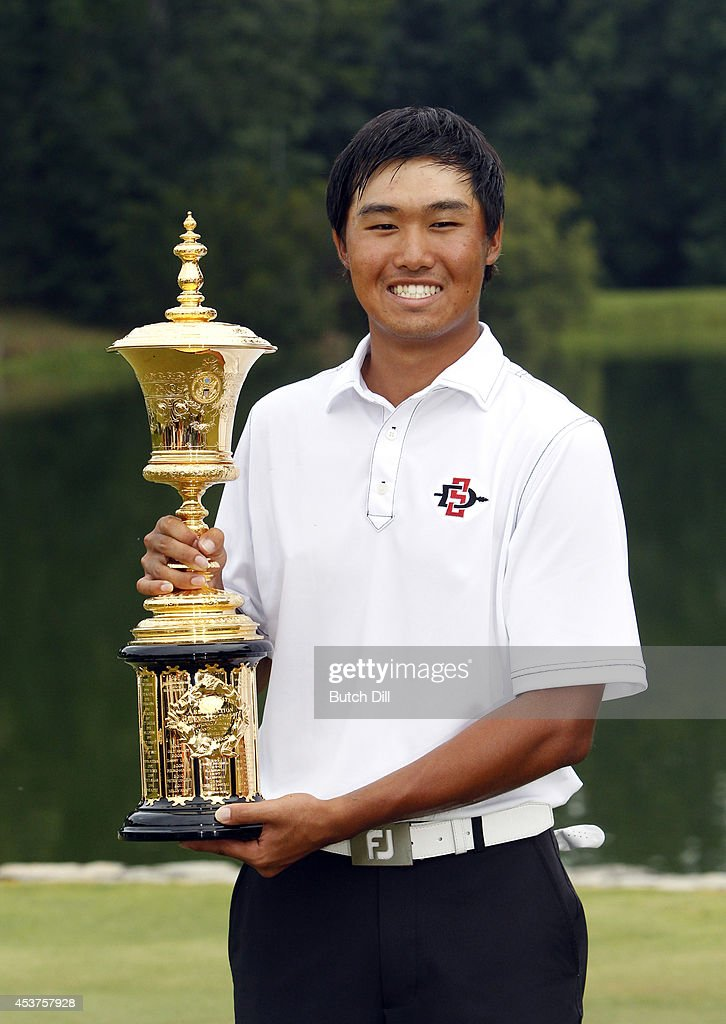 <a gi-track='captionPersonalityLinkClicked' href=/galleries/search?phrase=Gunn+Yang&family=editorial&specificpeople=13497510 ng-click='$event.stopPropagation()'>Gunn Yang</a> of Korea, kisses the trophy after defeating Corey Conners of Canada, to win the U.S. Amateur Championship 2-1 on the seventeenth hole on August 17, 2014 at the Atlanta Athletic Club in Johns Creek, Georgia.
