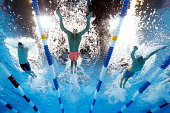 Gunnar Bentz Ryan Lochte and Austin Surhoff of the United States compete in a heat for the Men's 200 Meter Individual Medley during Day Five of the...