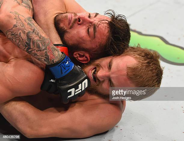 Gunnar Nelson attempts to submit Brandon Thatch in their welterweight fight during the UFC 189 event inside MGM Grand Garden Arena on July 11 2015 in...
