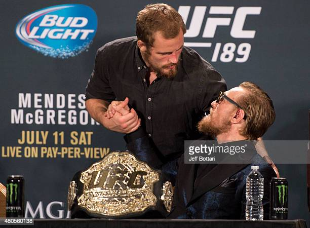 Gunnar Nelson greets Conor McGregor during the UFC 189 post fight press conference at the MGM Grand Garden Arena on July 11 2015 in Las Vegas Nevada