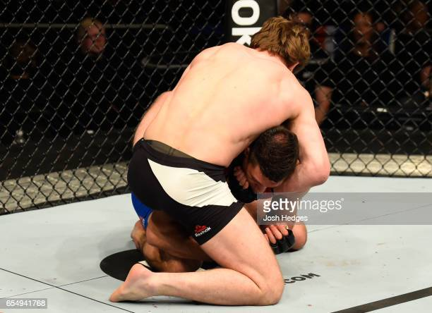 Gunnar Nelson of Iceland attempts to submit Alan Jouban of the United States in their welterweight fight during the UFC Fight Night event at The O2...