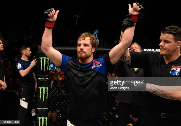 Gunnar Nelson of Iceland celebrates his submission victory over Alan Jouban of the United States in their welterweight fight during the UFC Fight...