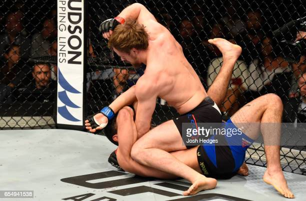 Gunnar Nelson of Iceland punches Alan Jouban of the United States in their welterweight fight during the UFC Fight Night event at The O2 arena on...