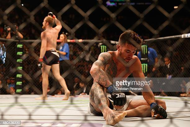Gunnar Nelson reacts to his victory over Brandon Thatch in their welterweight fight during the UFC 189 event inside MGM Grand Garden Arena on July 11...