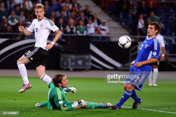 Gunnar Nielsen Faeroe Islands and Jonas Naes Faeroe Islands save the ball against Marco Reus of Germany during the FIFA 2014 World Cup Qualifier...