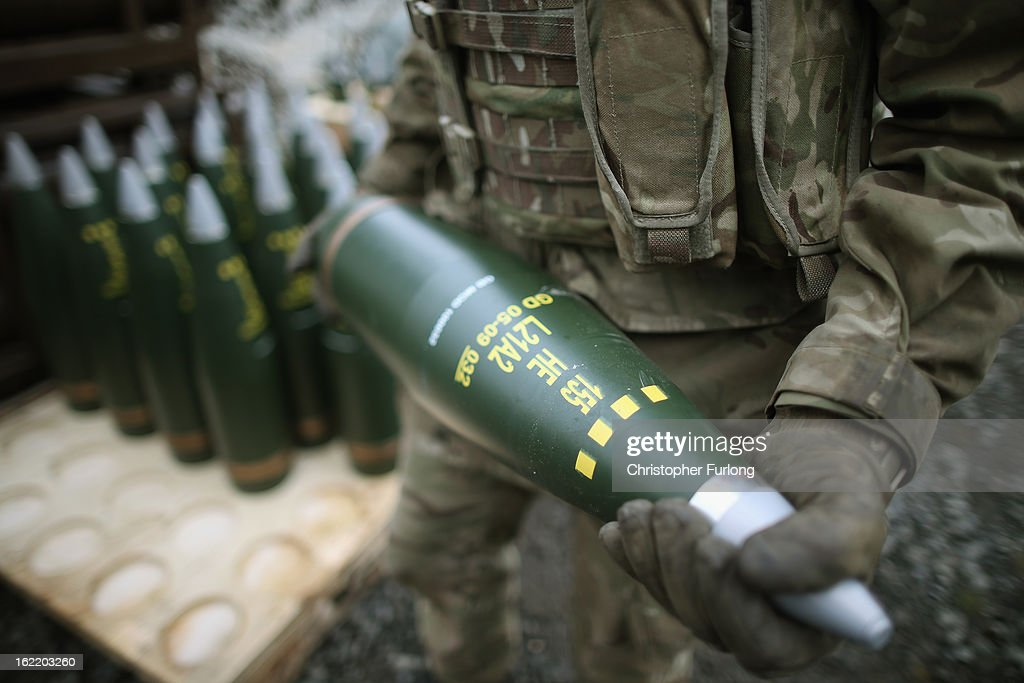 A gunner from the Royal Artillery carries a high explosive shell ready for firing during an exercise on February 20, 2013 in Otterburn, United Kingdom. Artillery units from Brtain and France are taking part in an intensive training exercise for Regular and Reserve Army units preparing for Afghanistan at the Otterburn training area in Northumberland. French Fire Support Teams, who work alongside their infantry units calling in artillery support, are learning to work with the Royal Artillery for future combat.
