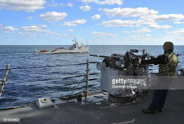 Gunner's Mate mans the MK-38 25mm machine gun aboard USS Porter.