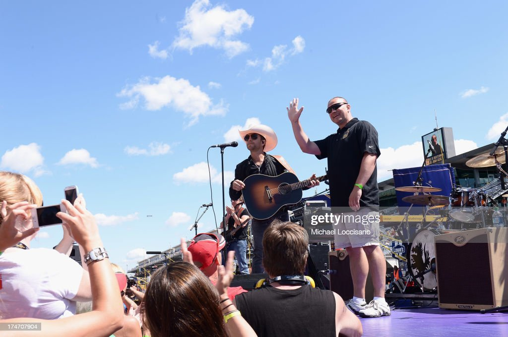 Gunnery Sergeant Samuel Deeds (R) poses with country music singer <a gi-track='captionPersonalityLinkClicked' href=/galleries/search?phrase=Justin+Moore&family=editorial&specificpeople=2437772 ng-click='$event.stopPropagation()'>Justin Moore</a> onstage at Indianapolis Motor Speedway on July 28, 2013 in Indianapolis, Indiana. As winner of the annual Crown Royal 'Your Hero's Name Here' program, Deeds received naming rights to the July 28th NASCAR Sprint Cup Series race at the Brickyard.