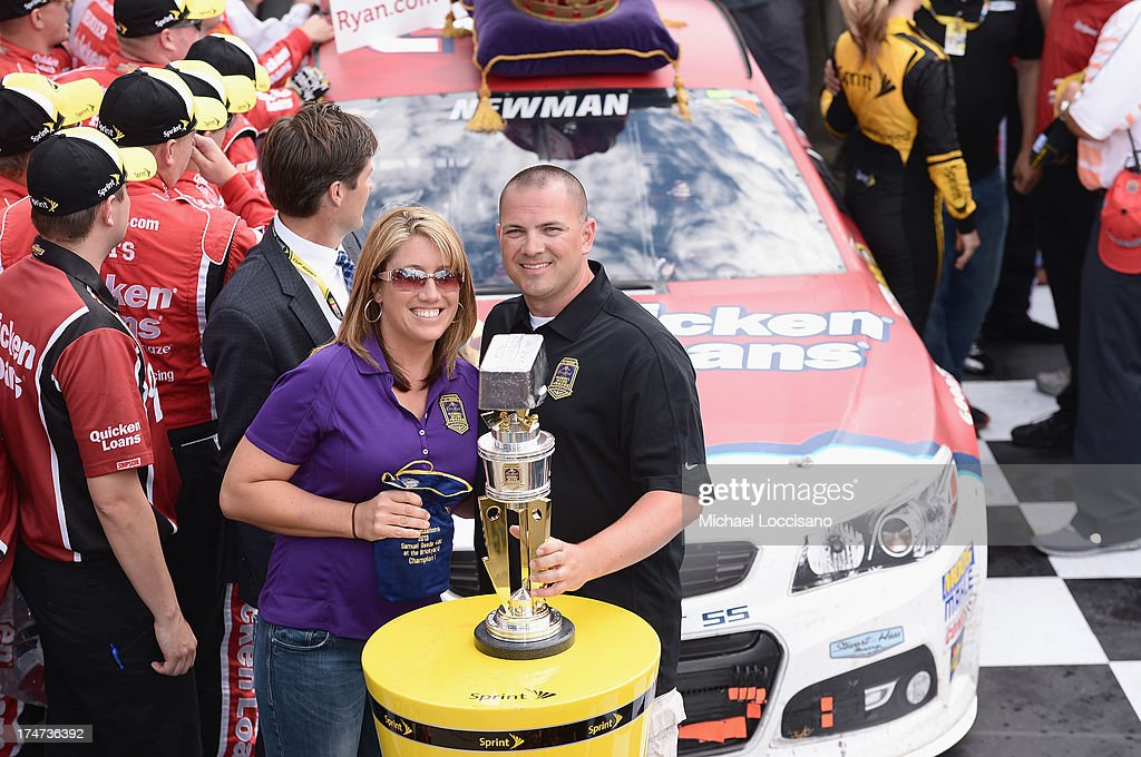Gunnery Sergeant Samuel Deeds poses with his wife April at Indianapolis Motor Speedway on July 28, 2013 in Indianapolis, Indiana. As winner of the annual Crown Royal 'Your Hero's Name Here' program, Deeds received naming rights to the July 28th NASCAR Sprint Cup Series race at the Brickyard.
