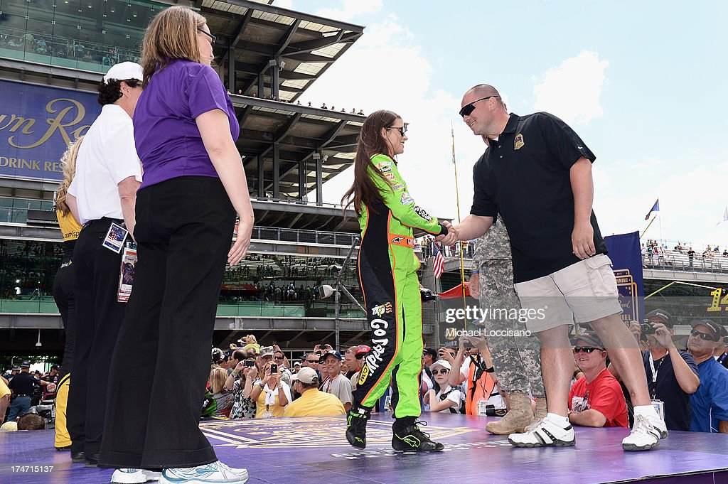 Gunnery Sergeant Samuel Deeds shakes hands with NASCAR driver <a gi-track='captionPersonalityLinkClicked' href=/galleries/search?phrase=Danica+Patrick&family=editorial&specificpeople=183352 ng-click='$event.stopPropagation()'>Danica Patrick</a> at Indianapolis Motor Speedway on July 28, 2013 in Indianapolis, Indiana. As winner of the annual Crown Royal 'Your Hero's Name Here' program, Deeds received naming rights to the July 28th NASCAR Sprint Cup Series race at the Brickyard.