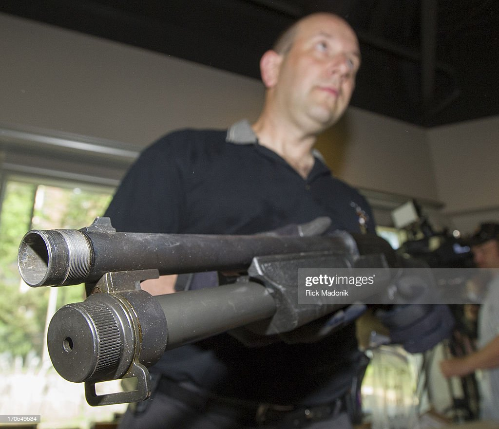 Guns and Gangs Detective Bob Rodeghiero, holds a 12 gauge shotgun, just one of the weapons seized in Project Traveller, a year long investigation into guns and drugs in the city's north west section. Money and guns were shown to the media at 23 Division this morning after yesterday's raids. Toronto Police launched a massive predawn raid On June 13, 2013, as part of Project Traveller, targeting guns and drugs, and focusing on the Toronto neighbourhood that is ground zero for the Mayor Rob Ford crack video scandal.