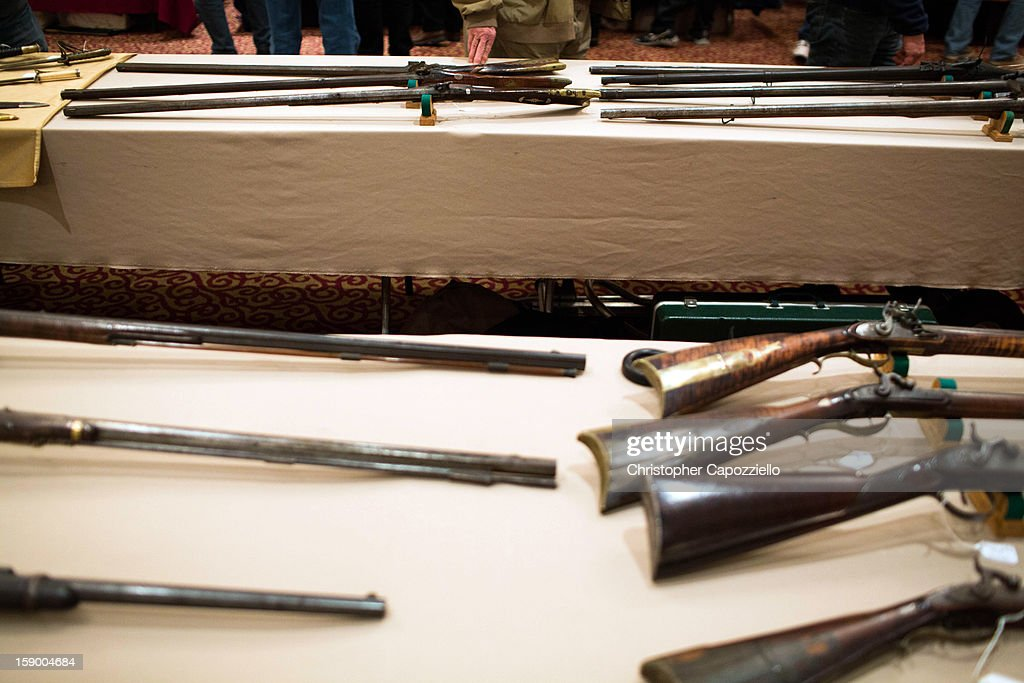 Guns are displayed at a gun show held by Westchester Collectors Inc. at the Crowne Plaza Hotel on January 5, 2013 in Stamford, Connecticut. While other area gun shows have been canceled following the shooting rampage that killed 20 first-graders and six teachers and administrators in Newtown, Connecticut last month, a gun show in Stamford, 30 miles from Newtown, is going on as planned.