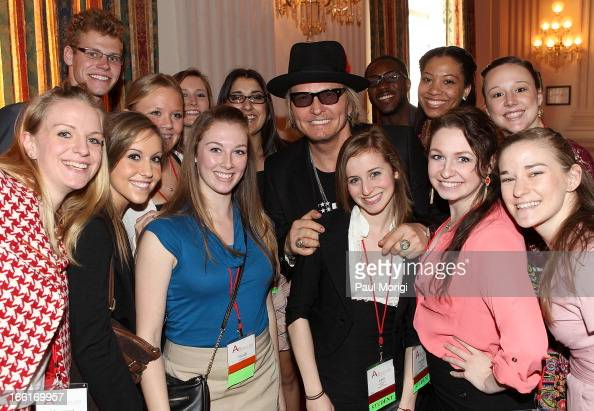 Guns N' Roses drummer Matt Sorum on behalf of Ovation poses for a photo with fans on Arts Advocacy Day sponsored by Ovation at Cannon House Office...