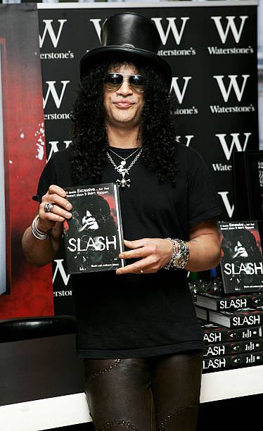 guns n 39 roses former lead guitarist slash signs copies of his new book photos and images getty. Black Bedroom Furniture Sets. Home Design Ideas