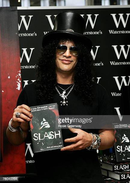 Guns 'N' Roses former lead guitarist Saul 'Slash' Hudson signs copies of his autobiography 'Slash' at Waterstones Piccadilly on November 21 2007 in...