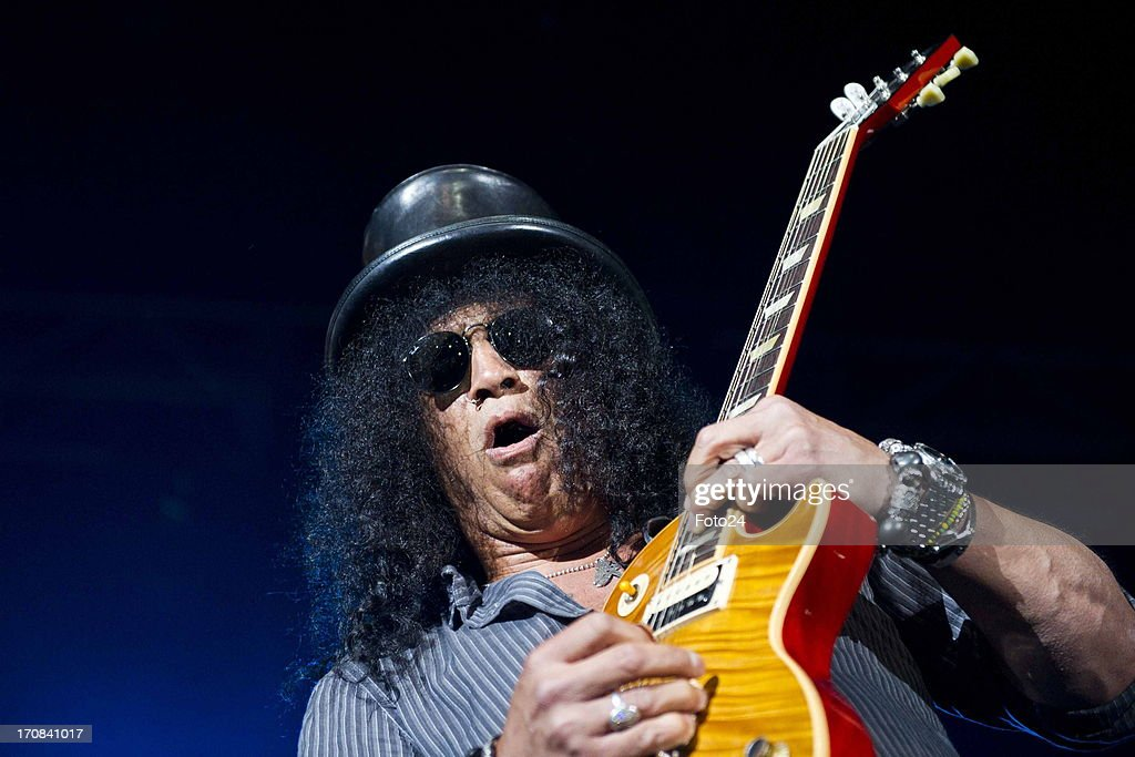 Guns n Roses guitarist Slash during the Kings of Chaos concert on June 16, 2013 in Sun City, South Africa. Kings of Chaos performed in Sun City on June 15 and 16, 2013.