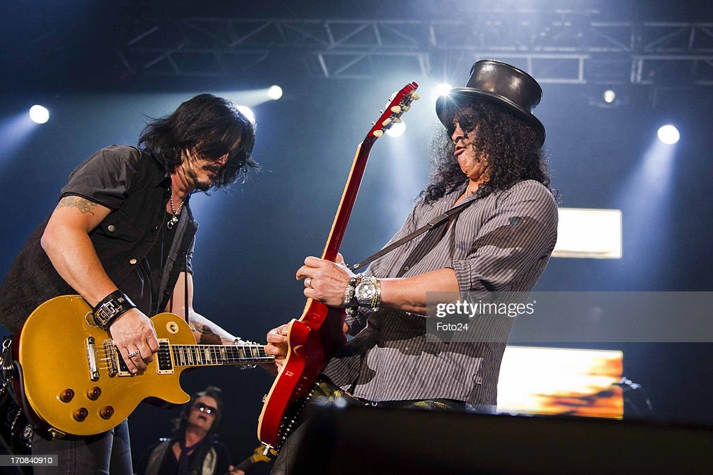 Guns n Roses musicians Gilby Clarke and Slash during the Kings of Chaos concert on June 16, 2013 in Sun City, South Africa. Kings of Chaos performed in Sun City on June 15 and 16, 2013.