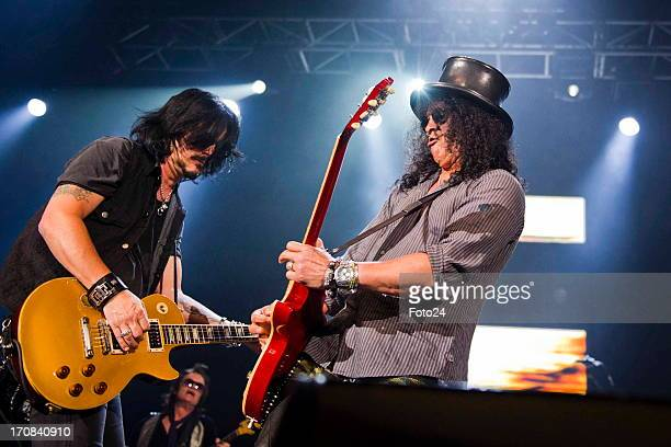 Guns n Roses musicians Gilby Clarke and Slash during the Kings of Chaos concert on June 16 2013 in Sun City South Africa Kings of Chaos performed in...