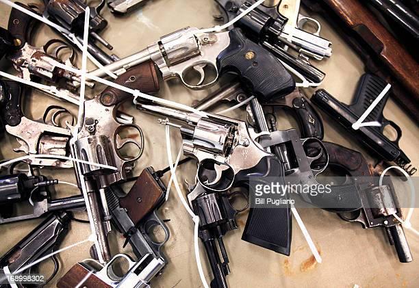 Guns people brought in to exchange for a $50 Meijer gift card at a 'Groceries For Guns' gun buyback program are shown May 18 2013 at the New St Paul...