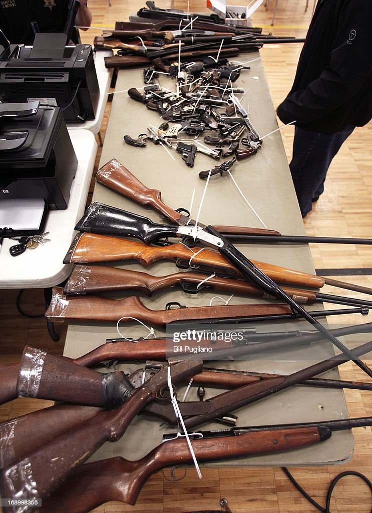 Guns people brought in to exchange for a $50 Meijer gift card at a 'Groceries For Guns' gun buyback program are shown May 18, 2013 at the New St. Paul Tabernacle Church of God in Christ in Detroit, Michigan. The event was sponsored by the law firm Goodman Acker P.C. in a public-private partnership with Wayne County.