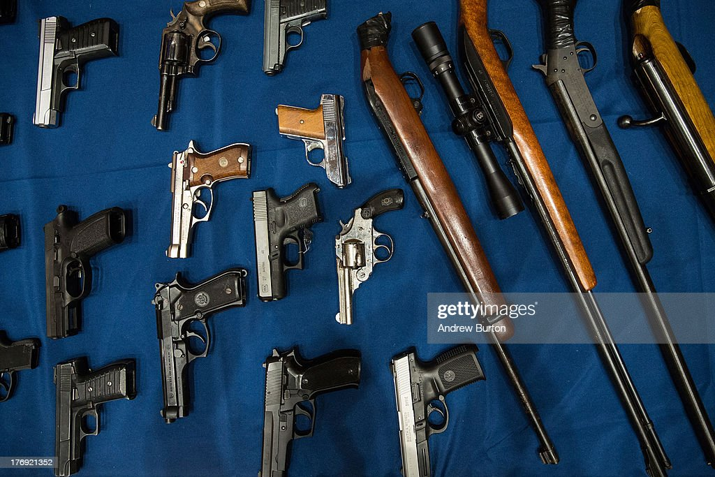 Guns seized by the New York Police Department in the largest seizure of illegal guns in the city's history are displayed on a table during a press...