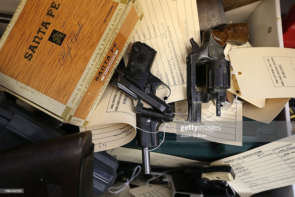 Guns sit in a box that were surrendered during a gun buy back program on December 15, 2012 in San Francisco, California. The San Francisco police department held a one-day gun buy back event that paid $200 per gun turned in. A better than expected crowd resulted in payback money running out and vouchers were issued to collect money within a week. Over 200 guns were collected.
