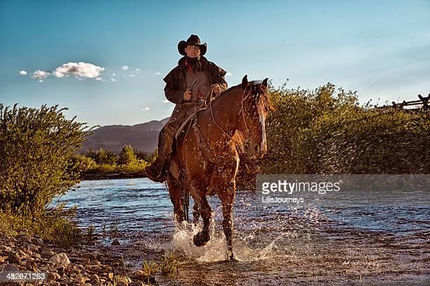 Gunslinger On Horseback Riding In The Riverbed