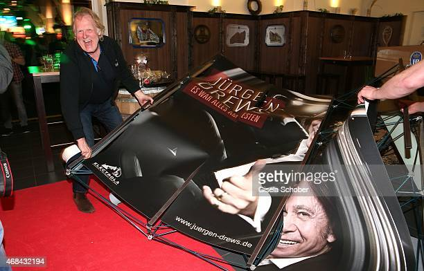 Gunter Gabriel breaks the wall during Juergen Drews' 70th Birthday Party at Hofbraeuhaus on April 02 2015 in Berlin Germany
