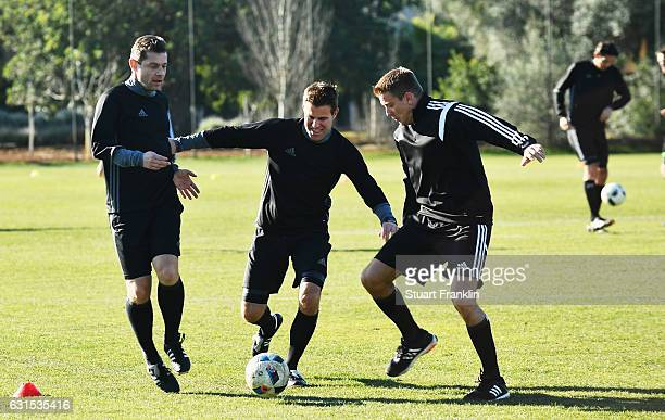 Gunter Perl tackles Felix Brych during the DFB Referee training course at the Hilton hotel on January 12 2017 in Palma de Mallorca Spain