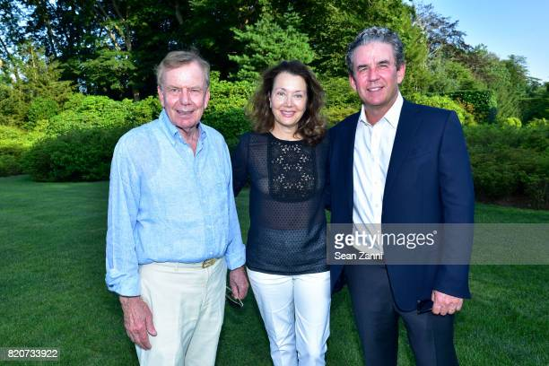 Gunter Reiner Lisa McCarthy and Brian McCarthy attend ARF in the Garden of Peter Marino at a Private Residence on July 15 2017 in Southampton NY