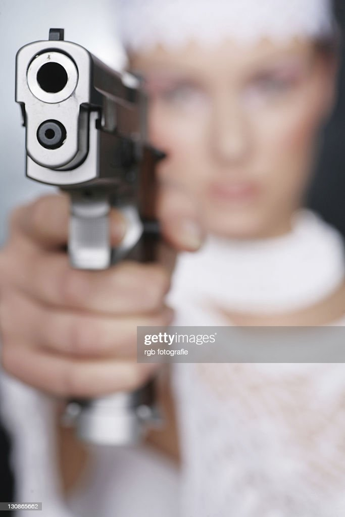 Gun-wielding moll : Stock Photo