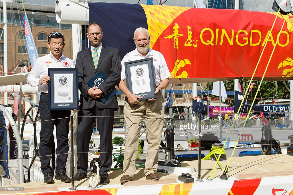 Guo Chuan (L), the first Chinese sailor to complete a solo circumnavigation in 2013, and Robin Knox-Johnston, the first man to sail solo non-stop around the world in 1968-69, (R) stand with their certificates in Saint Katherine's Dock in London on August 30, 2013, after being presented with Guinness World Record honours for their achievements. The Clipper 2013-14 Round the World Yacht Race starts September 1 from London and will return almost a year later after completing the 40,000-mile route.