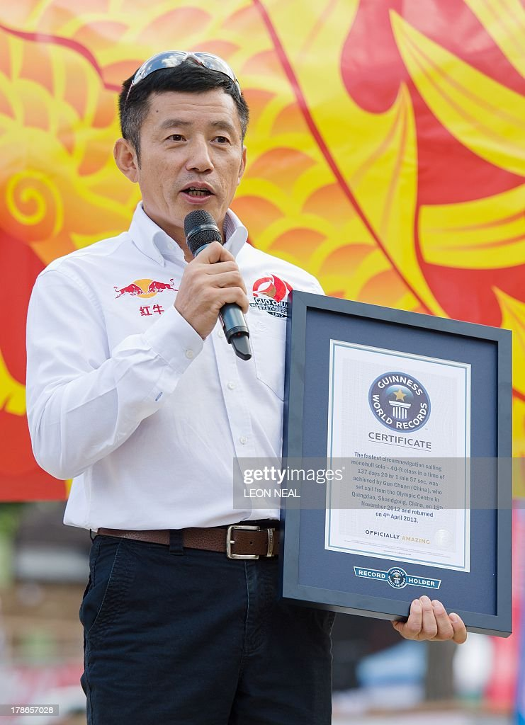 Guo Chuan, who became the first Chinese sailor to complete a solo circumnavigation of the world in 2013, speaks holding his Guinness World Record certificate at Saint Katherine's Dock in London on August 30, 2013. The Clipper 2013-14 Round the World Yacht Race starts September 1 from London and will return almost a year later after completing the 40,000-mile route. AFP PHOTO / LEON NEAL