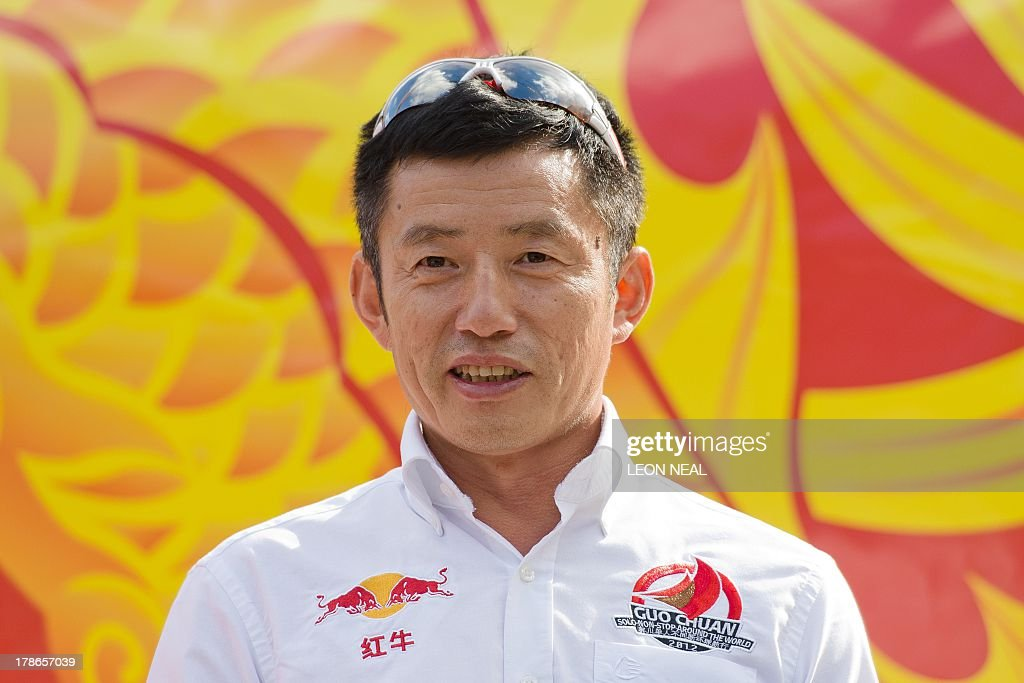 Guo Chuan, who became the first Chinese sailor to complete a solo circumnavigation of the world in 2013, speaks with guests at Saint Katherine's Dock in London on August 30, 2013 after being presented with a Guinness World Record certificate for his achievement. The Clipper 2013-14 Round the World Yacht Race starts September 1 from London and will return almost a year later after completing the 40,000-mile route.
