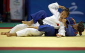 Guo Huaping of China fights with Laura Garcia of Spain during the 2008 Beijing Paralympic Games women's 48kg preliminary judo competition at the...