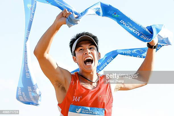 Guo Jianli of China celebrates winning the Modern Pentathlon Men's Individual Combined in day fourteen of the 2014 Asian Games at Dream Park...