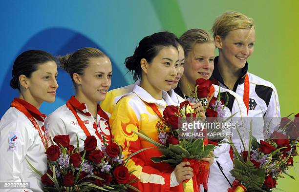 Guo Jingjing and Wu Minxia of China pose with their gold medals with silver medalists Julia Pakhalina and Anastasia Pozdnyakova of Russia and bronze...