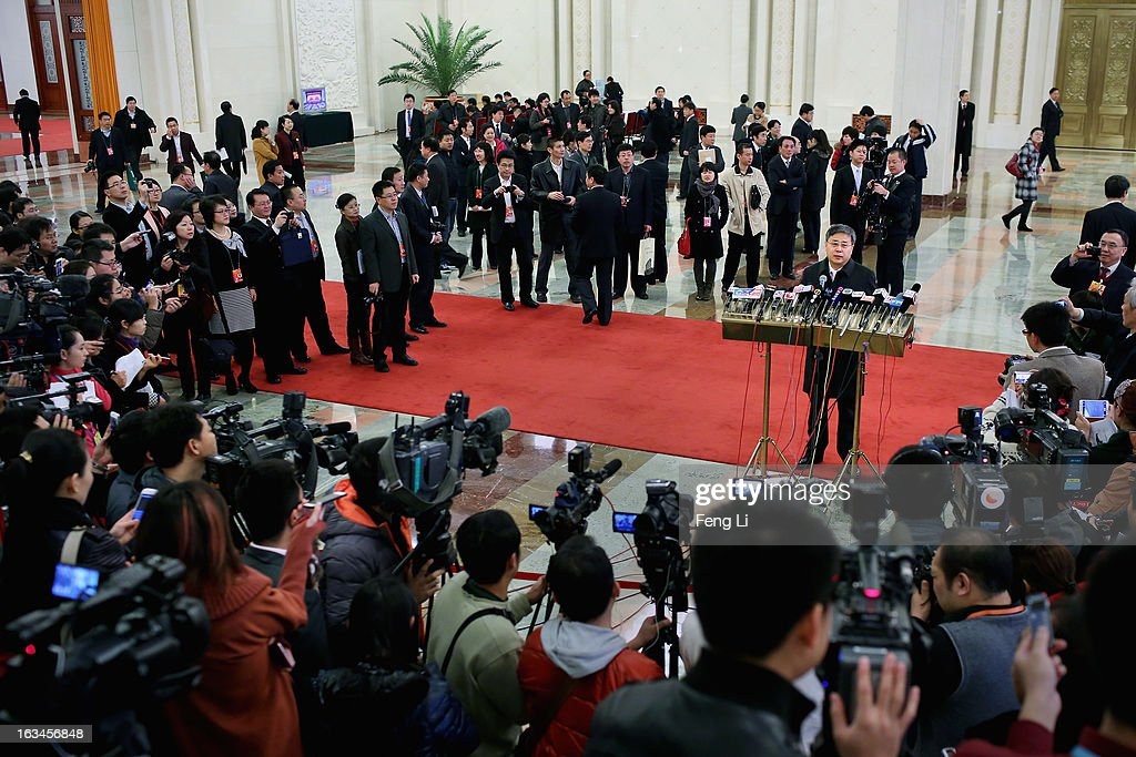 Guo Shuqing, Chairman of China Securities Regulatory Commission, answers media questions as he arriving at the Great Hall of the People to attend a plenary session of the National People's Congress on March 10, 2013 in Beijing, China. The State Council, China's cabinet, will begin its seventh restructuring attempt in the past three decades to roll back red tape and reduce administrative intervention. Several departments under the State Council will be reorganized according to a plan on the institutional restructuring and functional transformation of the State Council, which was submitted to the plenary session of the National People's Congress Sunday.