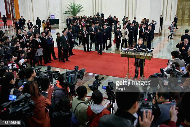 Guo Shuqing Chairman of China Securities Regulatory Commission answers media questions as he arriving at the Great Hall of the People to attend a...