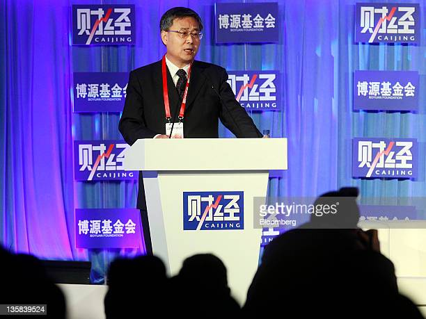 Guo Shuqing chairman of China's Securities Regulatory Commission speaks at the Caijing Annual Conference 2012 in Beijing China on Thursday Dec 15...