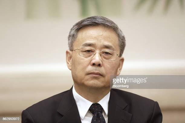 Guo Shuqing chairman of the China Banking Regulatory Commission attends a news conference at the Great Hall of the People during the 19th National...