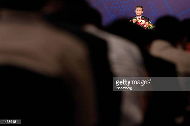 Guo Shuqing chairman of the China Securities Regulatory Commission speaks to an audience at the Lujiazui Forum in Shanghai China on Friday June 29...