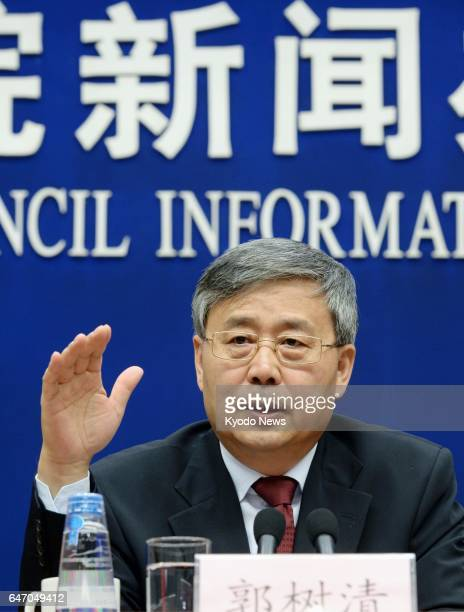 Guo Shuqing new chairman of the China Banking Regulatory Commission speaks at a news conference in Beijing on March 2 2017 Guo vowed to strengthen...
